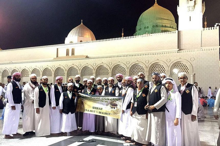 Some of the Zam Zam staff during their sponsored umrah, or minor pilgrimage, to Mecca. They wore Zam Zam vests for easy identification and took along a banner which they posed with for photos.