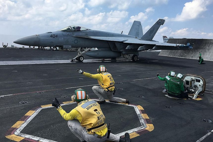 Fighter planes being launched from the nuclear-powered aircraft carrier USS Ronald Reagan in the South China Sea earlier this month. According to the writer, what purports to be current US policy towards the South China Sea is a continuance of the Ob