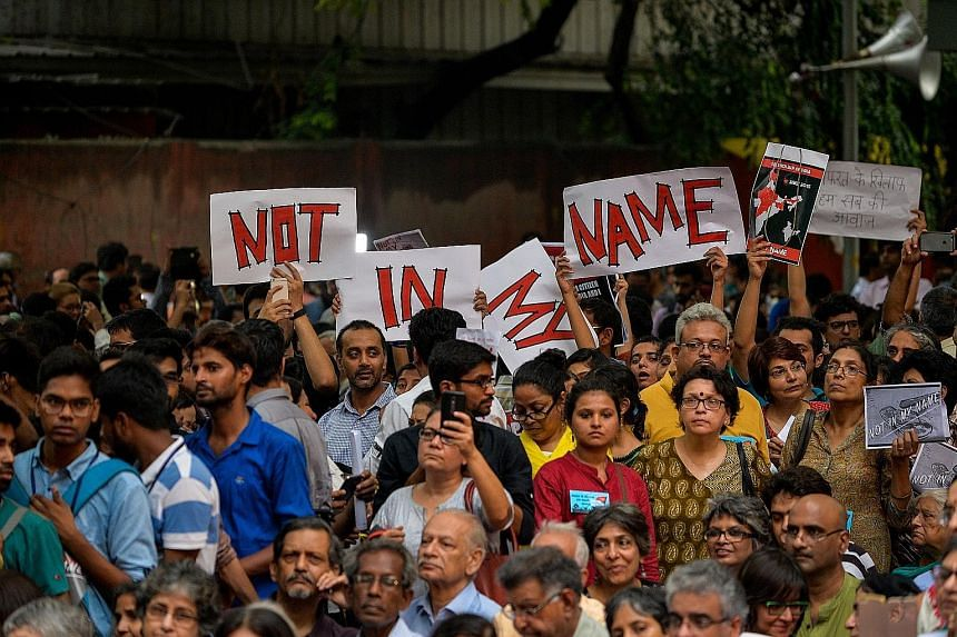 """Protesters at a """"Not in my name"""" rally in New Delhi on Wednesday, denouncing a spate of lynchings by so-called cow protectors. The killings have rattled India's religious minorities."""