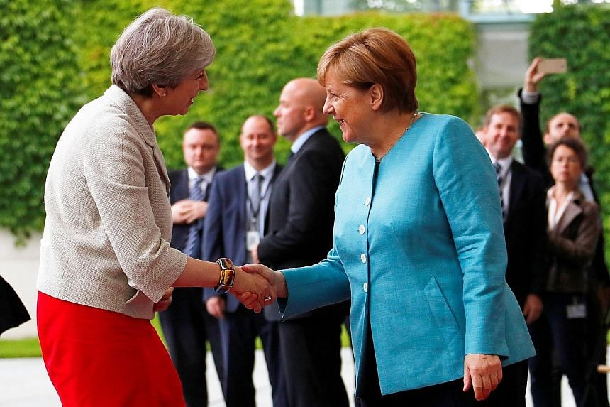 It was a busy day yesterday for British Prime Minister Theresa May, seen here being welcomed by German Chancellor Angela Merkel, in Berlin. She jetted into Germany for a meeting with other world leaders ahead of the Group of 20 (G-20) summit, then he