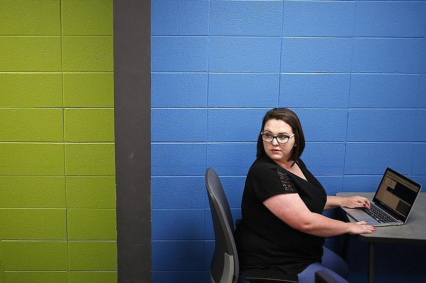 Interapt software quality assurance engineer Nichole Clark at the company's office. She was hired after a training stint, classes and an internship despite not having a college degree.