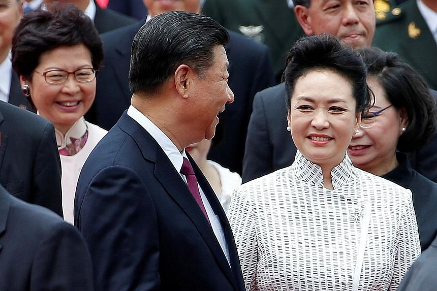 Mr Xi Jinping and his wife, Ms Peng Liyuan, being met by Chief Executive-elect Carrie Lam (behind left) in Hong Kong yesterday.