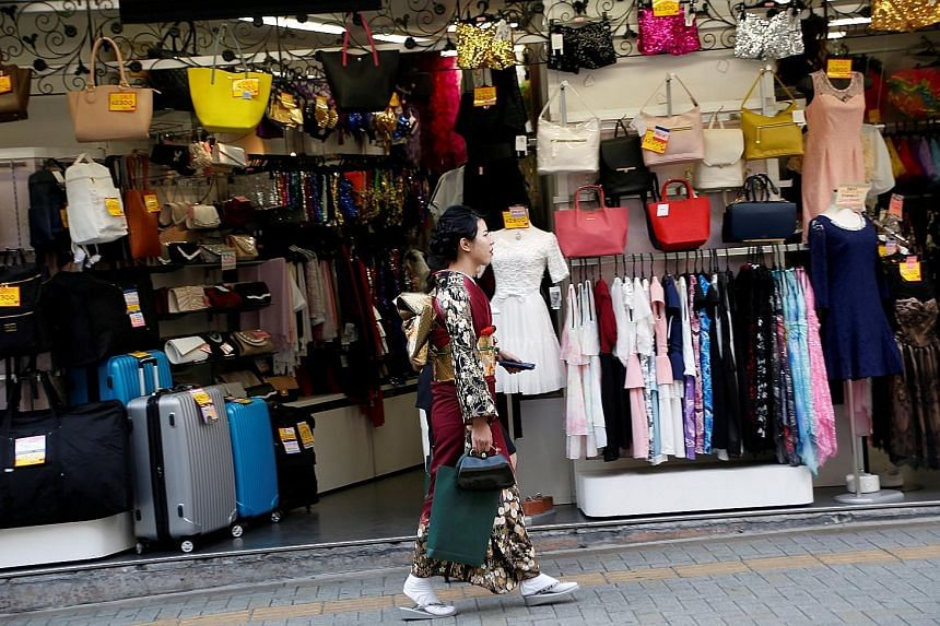 Sales in Japan fell 1.6 per cent last month from April. With wages stagnant or falling for years, growth in spending has been weak, and without a rebound in pay, it is unlikely that consumers will start spending a lot more.