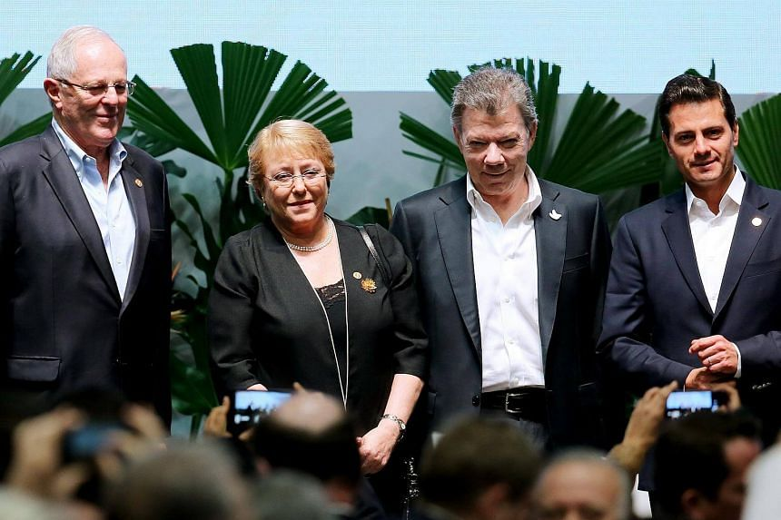 (From left) President of Peru Pedro Pablo Kuczynski, President of Chile Michelle Bachelet, President of Colombia Juan Manuel Santos and President of Mexico Enrique Pena Nieto, stand for photographers during the closing of the IV Business Meeting at t