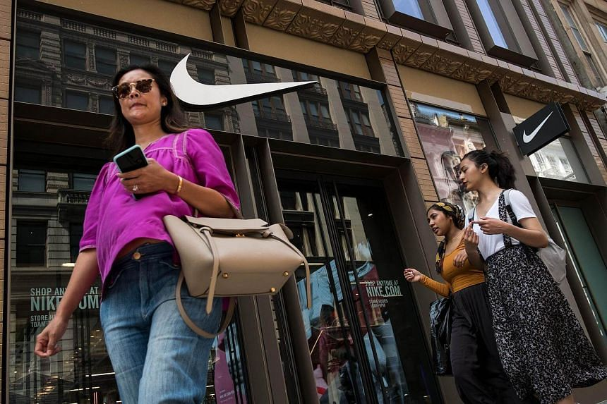 People walk past the Nike SoHo store in New York City.