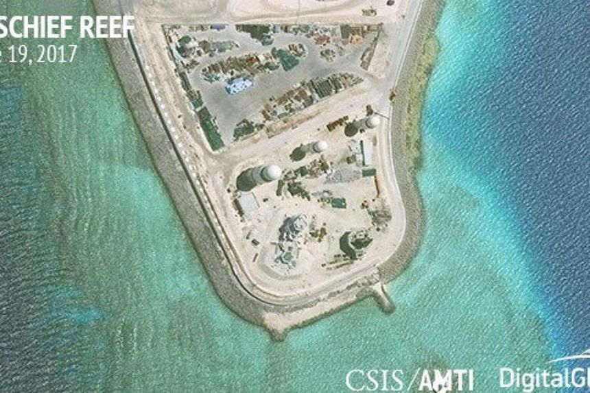 Construction is shown on Mischief Reef, in the Spratly Islands, the disputed South China Sea.