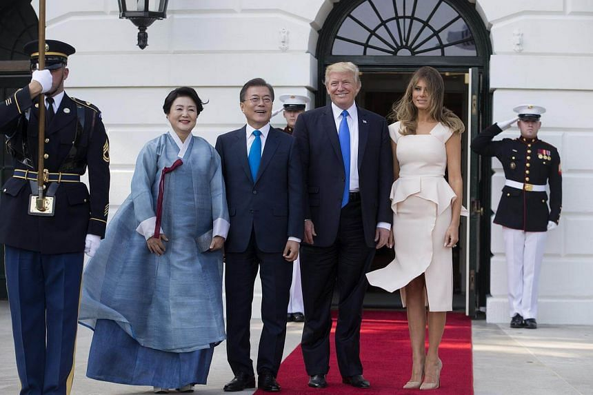 US President Donald Trump (centre right) and First Lady Melania Trump welcome President of South Korea Moon Jae In and his wife Kim Jung Sook at the South Portico of the White House in Washington, DC on June 29, 2017.
