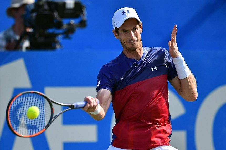 Andy Murray returns against Jordan Thompson during their men's singles first round tennis match at the ATP Aegon Championships tennis tournament at Queen's Club in west London.