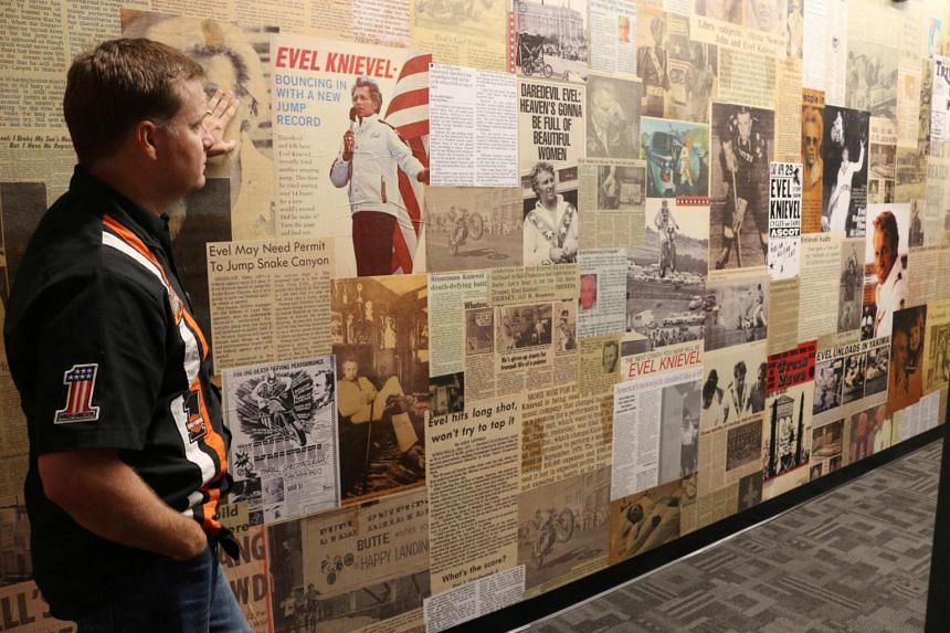 Mike Patterson, owner of historic Harley-Davidson and founder of The Evel Knievel Museum in Topeka, Kansas, surveying the wall of news clippings about the daredevil stunt rider in his Evel Knievel Museum on June 21, 2017.