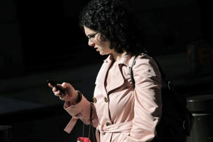 A woman using a smartphone in New York.
