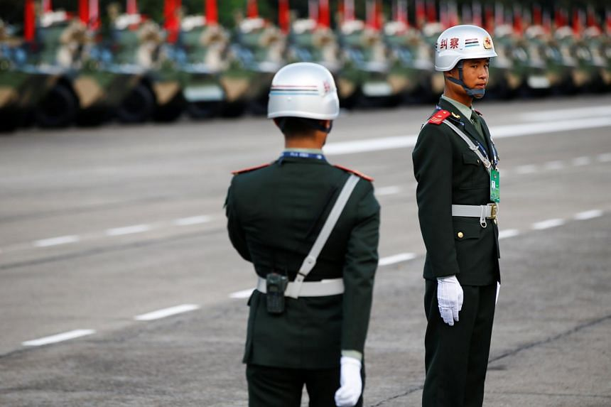 Soldiers standing at attention at a People's Liberation Army base in Hong Kong, on June 30, 2017.