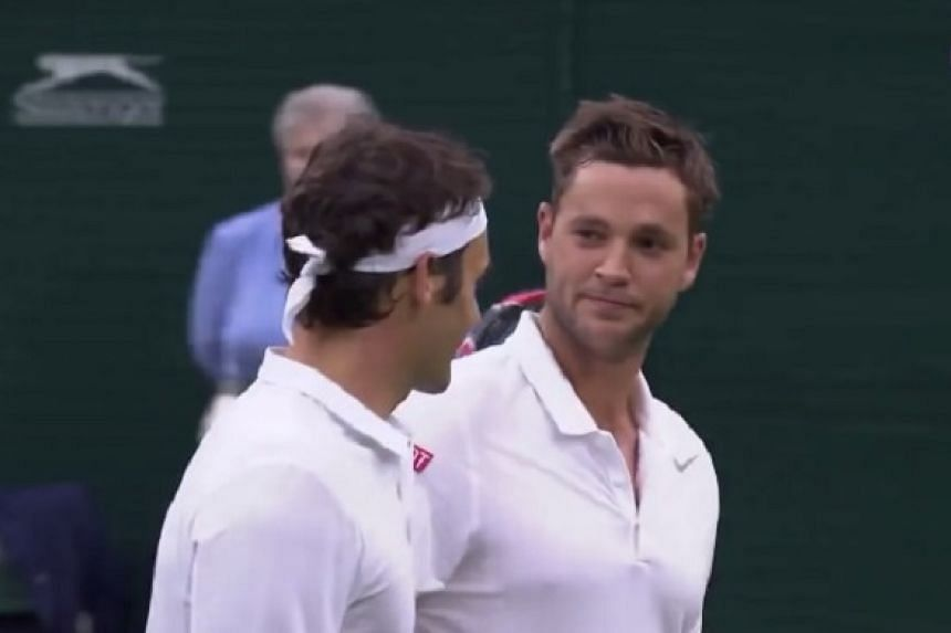Marcus Willis with Roger Federer after their second round Wimbledon clash in 2016.