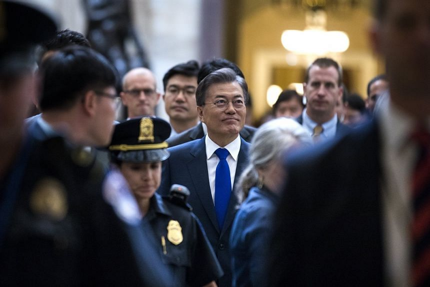 Moon Jae-in (centre) walks to a meeting with US Senators in the US Capitol.