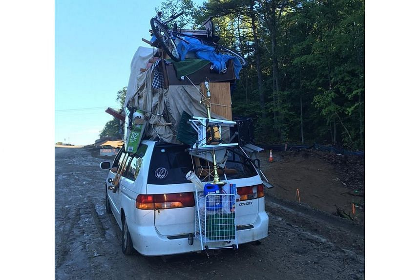 A car stopped by New Hampshire police that had objects including a bicycle and furniture stacked on it.