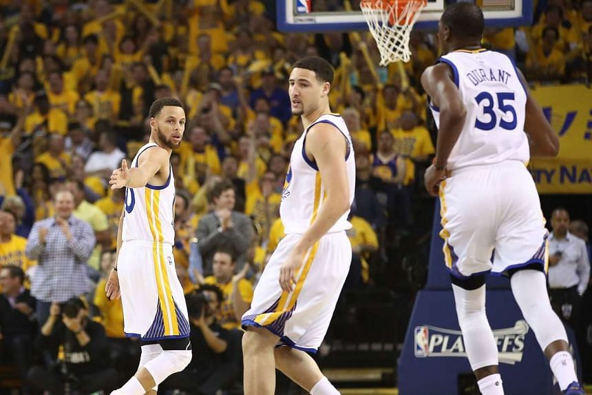Stephen Curry urging on Golden State Warriors team-mates Klay Thompson and Kevin Durant against the Utah Jazz during Game Two of the NBA Western Conference semi-finals at Oracle Arena on May 4, 2017 in Oakland, California.