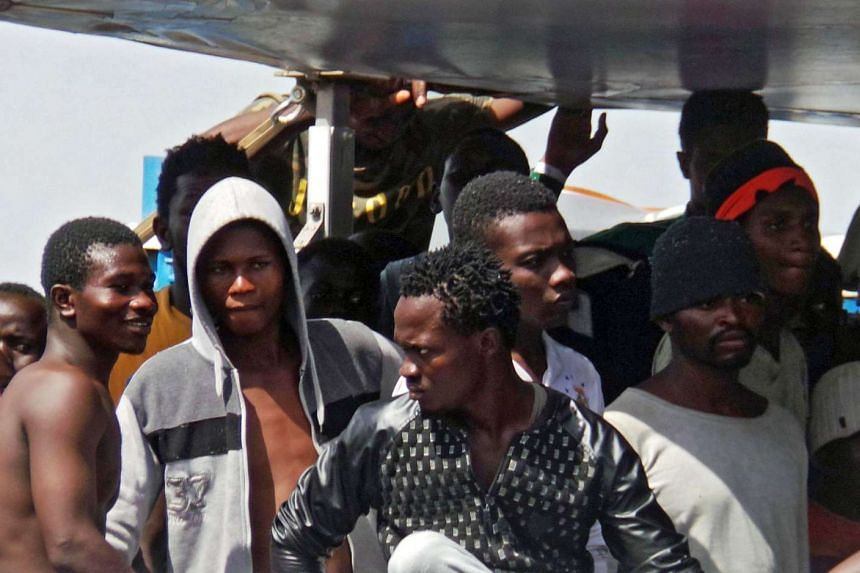 Migrants rescued from the Mediterranean Sea disembark from a ship in the port of Brindisi, Italy, June 30, 2017.
