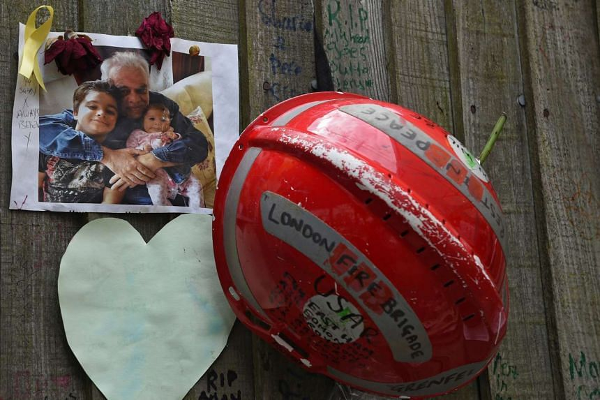 Mementos at a makeshift memorial for the victims of the Grenfell Tower fire.