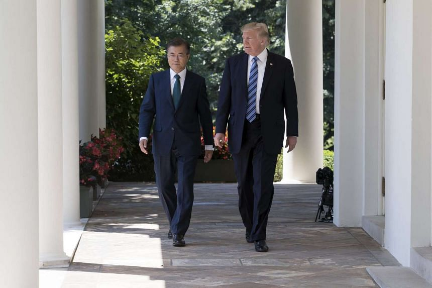 Moon (left) and Trump walk down the Colonnade to deliver joint statements in the Rose Garden.