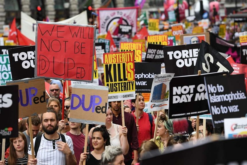 People taking part in the London anti-austerity demonstration, July 1, 2017.