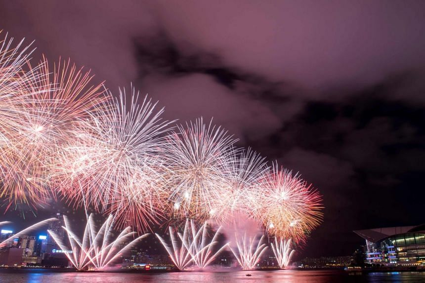 Fireworks exploding on Victoria Harbour in Hong Kong on July 1, 2017 to mark the 20th anniversary of the city's handover from British to Chinese rule.