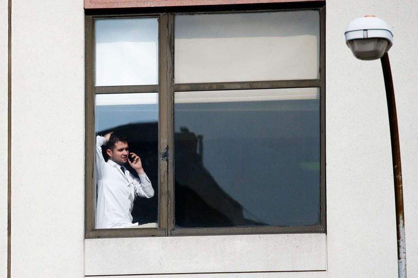 A doctor speaks on the phone inside the hospital after the incident.