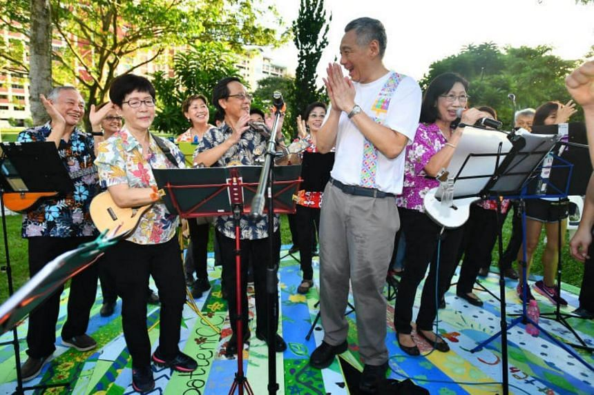 PM Lee Hsien Loong interacting with the golden ukulele strummers from Bishan North Community Arts and Culture Club.