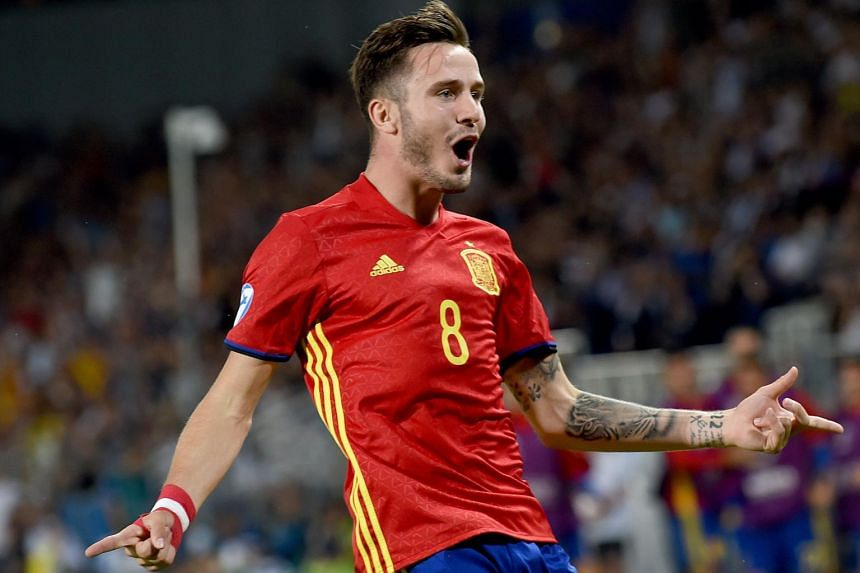Spain's midfielder Saul Niguez reacting after he scored a goal during the UEFA U-21 European Championship football semi final match between Spain and Italy in Krakow, Poland on June 27, 2017.