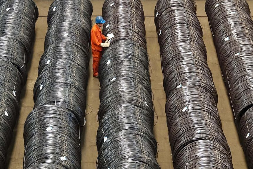 A worker checking steel wires at a warehouse in Dalian, Liaoning province, China on May 15, 2017.
