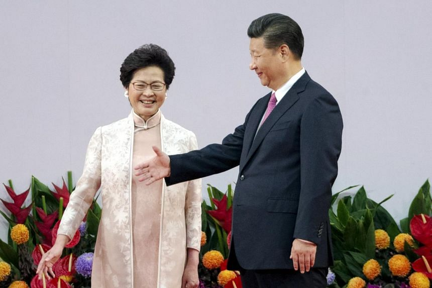 Xi Jinping and new Hong Kong Chief Executive Carrie Lam standing on stage after she is sworn in during her inauguration ceremony at the Hong Kong Exhibition and Convention Centre in Hong Kong, China, on July 1, 2017.