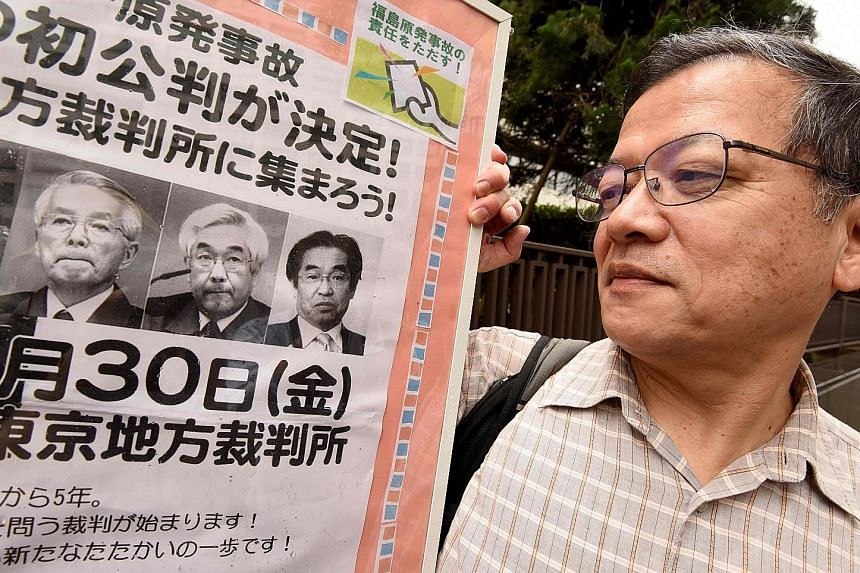 Three former executives at the operator of Japan's Fukushima nuclear plant went on trial yesterday, the only people to face a criminal court in connection with the 2011 disaster. The trio - (from left on board) former Tokyo Electric Power chairman Ts