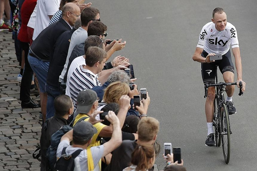 Chris Froome of Team Sky riding during the parade at the opening ceremony of the Tour de France in Dusseldorf.