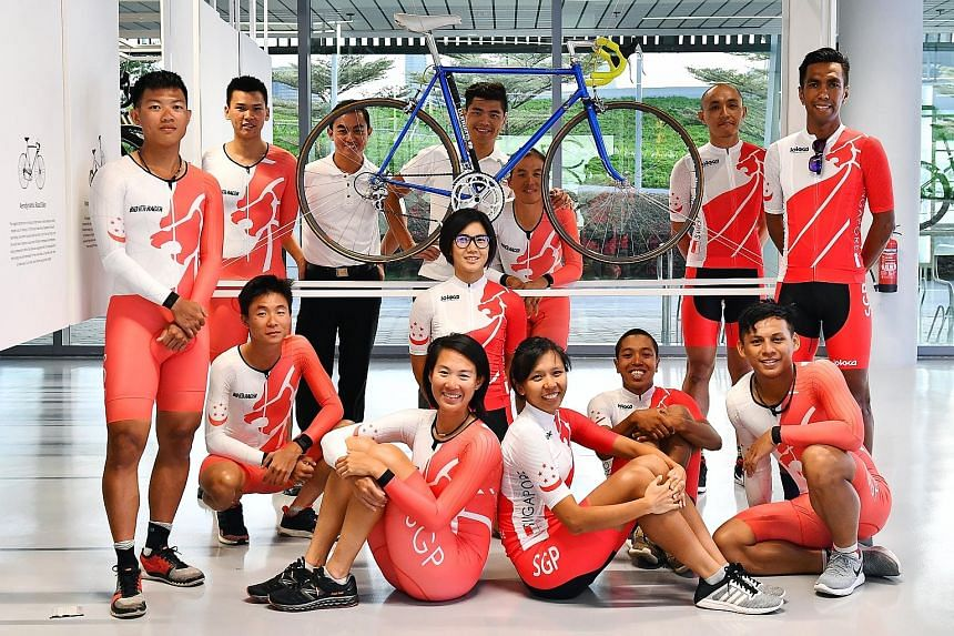 Singapore's cycling squad for the Kuala Lumpur SEA Games is confident of winning at least 10 bronzes. Lance Tan (second from the left, standing) and Dinah Chan (front row, left) will make a third and fifth appearance at the biennial competition respe