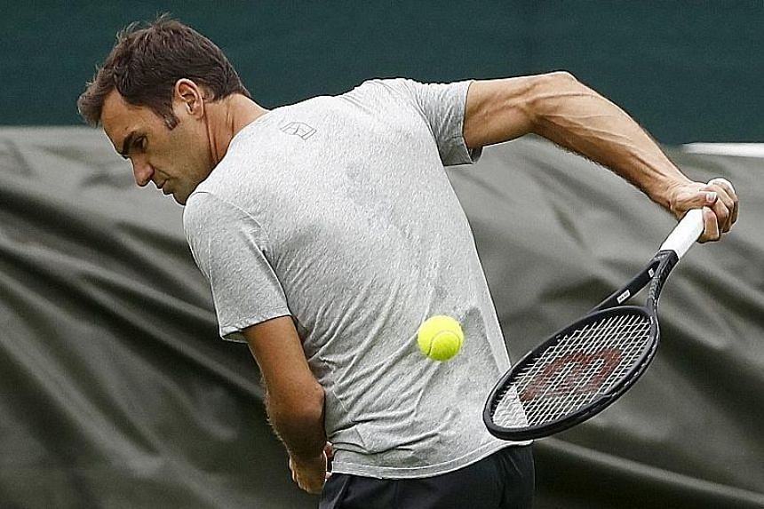 Swiss legend Roger Federer training at the All England Lawn Tennis Club yesterday. The seven-time Wimbledon champion is the bookies' favourite despite being seeded third and will start off against Ukraine's Alexandr Dolgopolov.