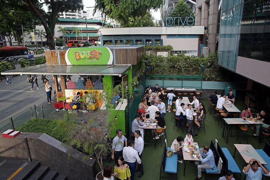 Left: Smoking areas at outdoor seating areas in eateries in Orchard Road will be a thing of the past come June 30 next year. Right: A smoking corner at a Toa Payoh coffee shop. New applications for smoking corners at food establishments will not be a
