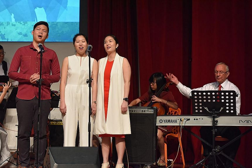 Members of the Singapore Pocket Opera Theatre (from left) Jeremy Koh, Charmaine Tan and Evelyn Ang performing NS50 tribute song Did You Ever Wonder Why yesterday. It was composed by the Singapore Chinese Orchestra's composer-in-residence Eric Watson