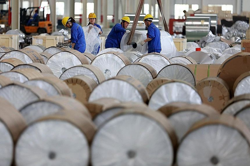 Workers packaging aluminium tapes in China's Anhui province. The manufacturing PMI was at 51.7 last month.
