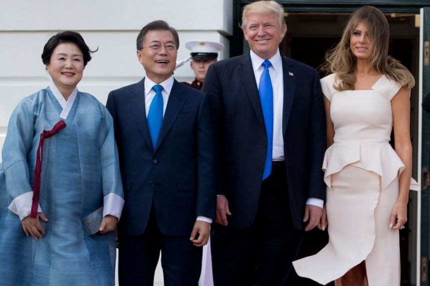 President Donald Trump and first lady Melania Trump welcoming South Korean President Moon Jae In and his wife, Kim Jung Sook at the South Portico of the White House in Washington, on June 29, 2017.