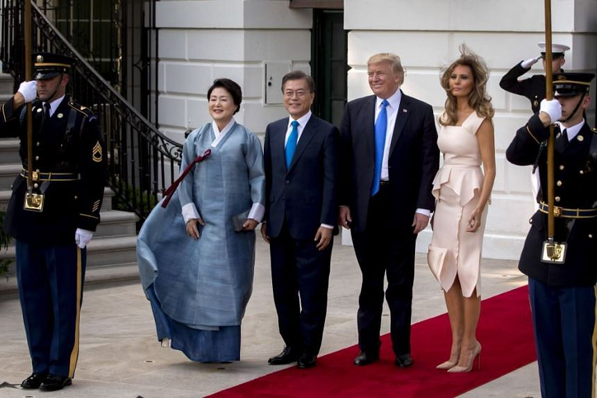 US First Lady Melania Trump, from right, US President Donald Trump, Moon Jae In, South Korea's president, and his wife Kim Jung Sook stand for photographers at the South Portico of the White House in Washington, DC, US on June 29, 2017.