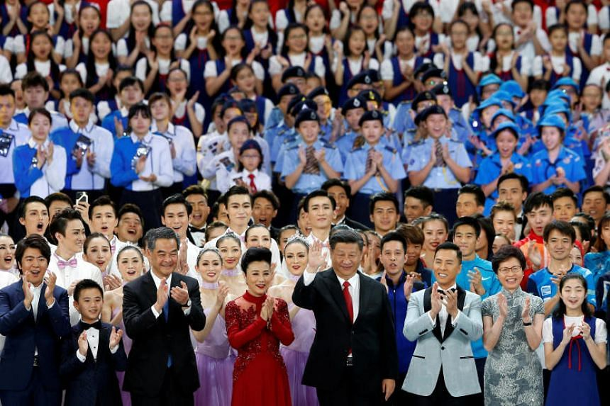 Chinese President Xi Jinping waves after a variety show, as part of the celebration for the 20th anniversary of the city's handover from British to Chinese rule