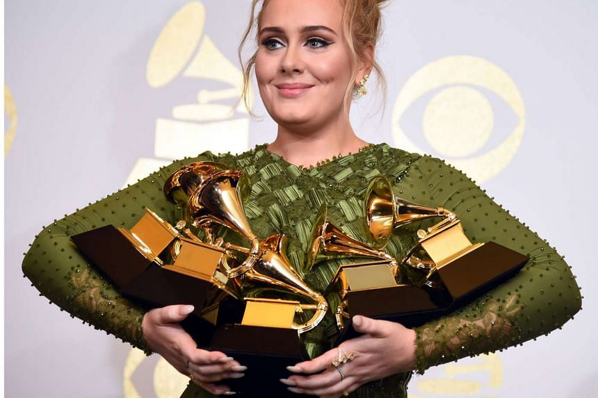 Adele poses with her Grammy awards in February 2017.