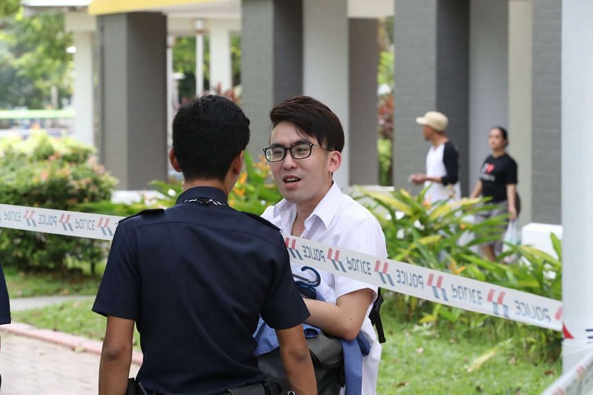 Mr Liu Yuanqi, one of the groomsmen whose car was hit, speaks to a police officer.