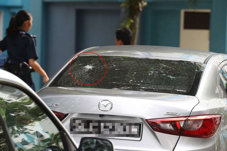 """The group of at least 17 were conducting """"gatecrashing"""" activities at a carpark in Woodlands when someone fired pellets at two cars."""