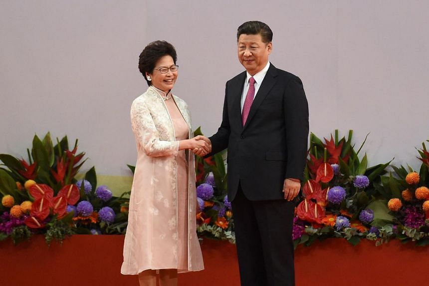 Hong Kong's new Chief Executive Carrie Lam (left) shaking hands with China's President Xi Jinping (right) after being sworn in as the territory's new leader, on July 1, 2017.