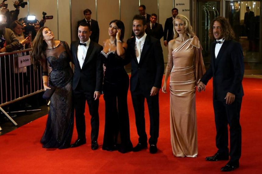 Argentine soccer player Lionel Messi's former Barcelona FC teammates, Xavi Hernandez and his wife Nuria Cunillera, Cesc Fabregas and his wife Daniella Semaan and Carles Puyol and wife Vanessa Lorenzo posing for photographers as they arrive at the wed