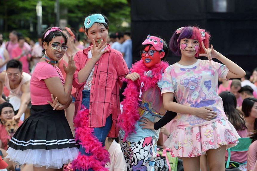 Supporters pose at the annual Pink Dot event at Hong Lim Park in Singapore on July 1, 2017.