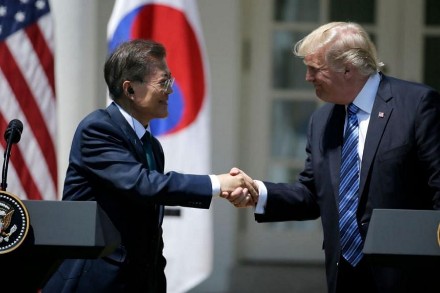 US President Donald Trump (right) greeting South Korean President Moon Jae In prior to delivering a joint statement from the Rose Garden of the White House, on June 30, 2017.