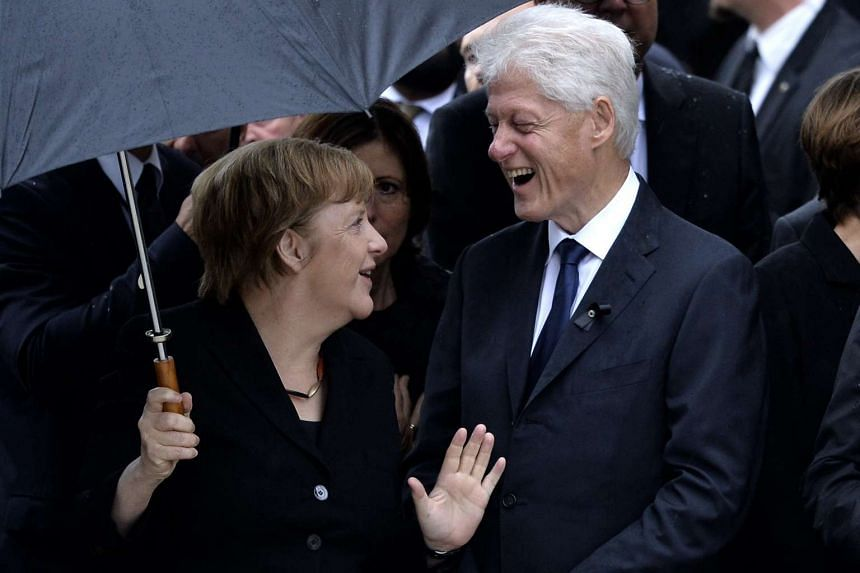 Angela Merkel and Bill Clinton at the service.