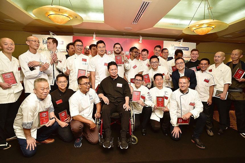 Chefs and representatives of restaurants that received Michelin stars during the launch of the second edition of Michelin Guide Singapore last Thursday.