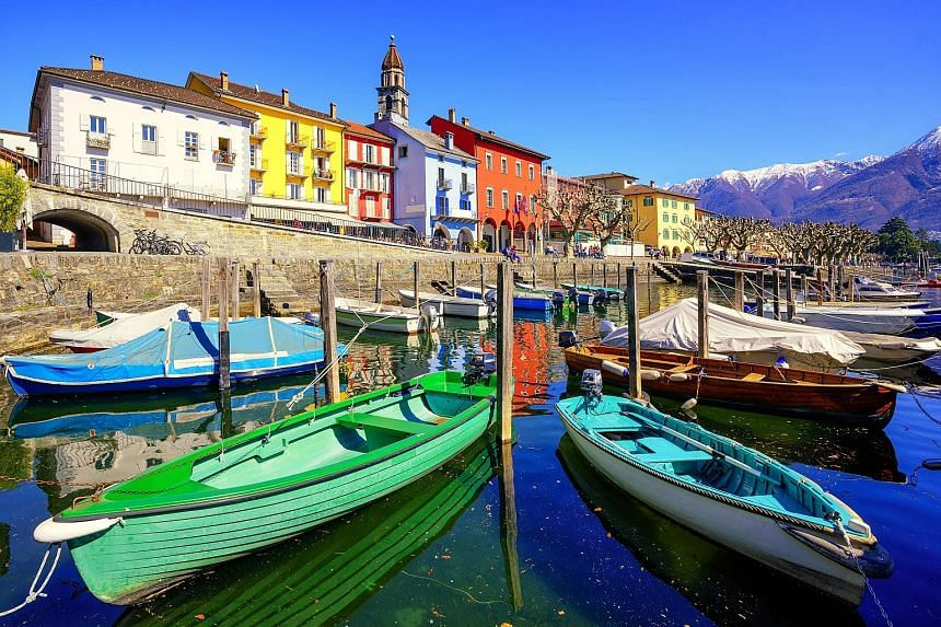 Vibrant-coloured boats stand out in the old town of Ascona.