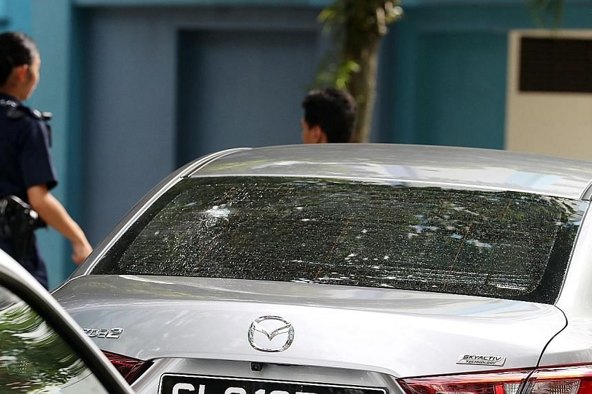 Groomsman Liu Yuanqi, who owns one of the two cars hit by pellets, at the scene yesterday.